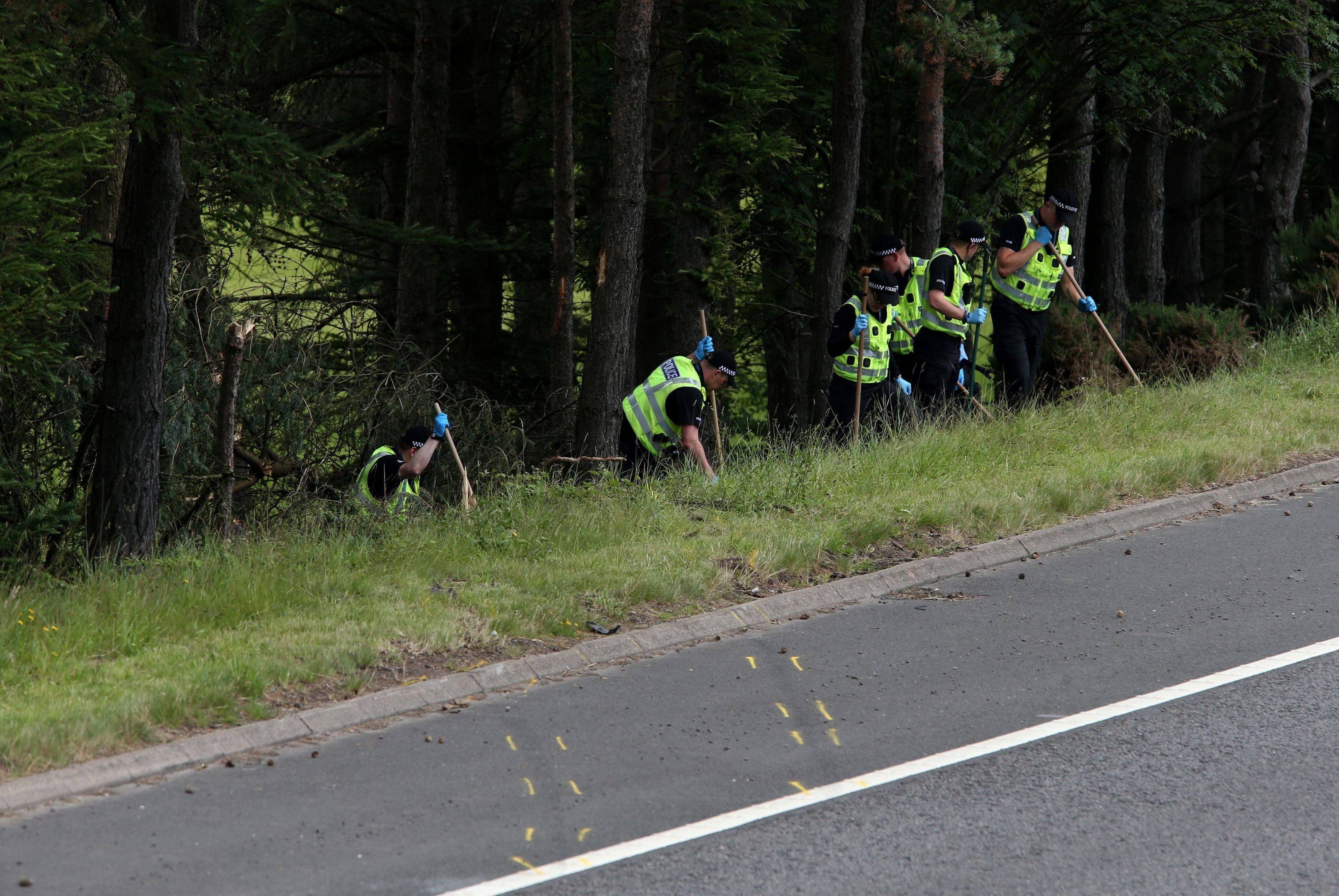 Police Officers searching the scene at Junction 9 of the M9 crash. (Andrew Milligan/PA Wire)