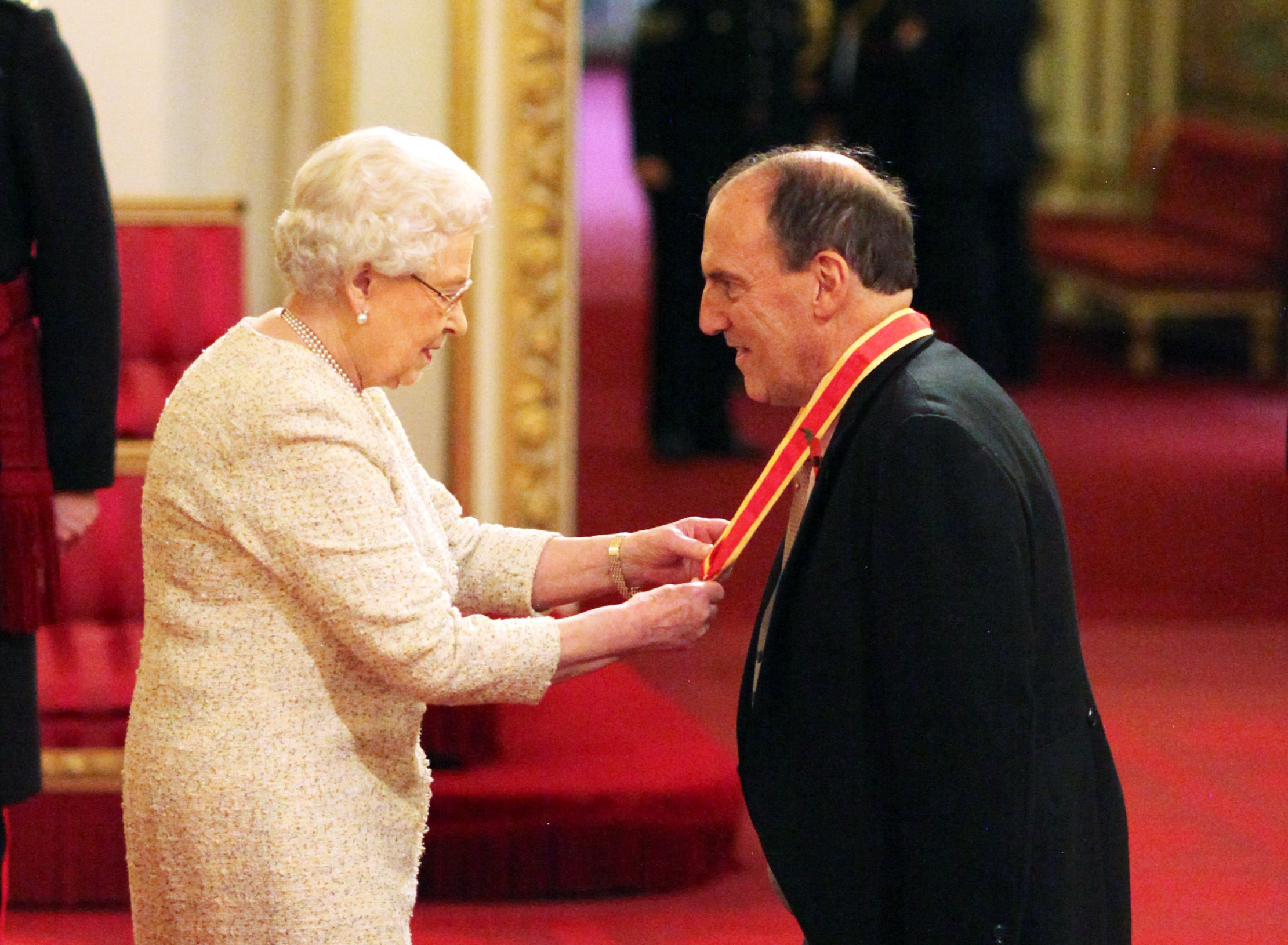 Sir Simon Hughes from London is made a Knight Bachelor of the British Empire from Queen Elizabeth II at an Investiture Ceremony at Buckingham Palace
