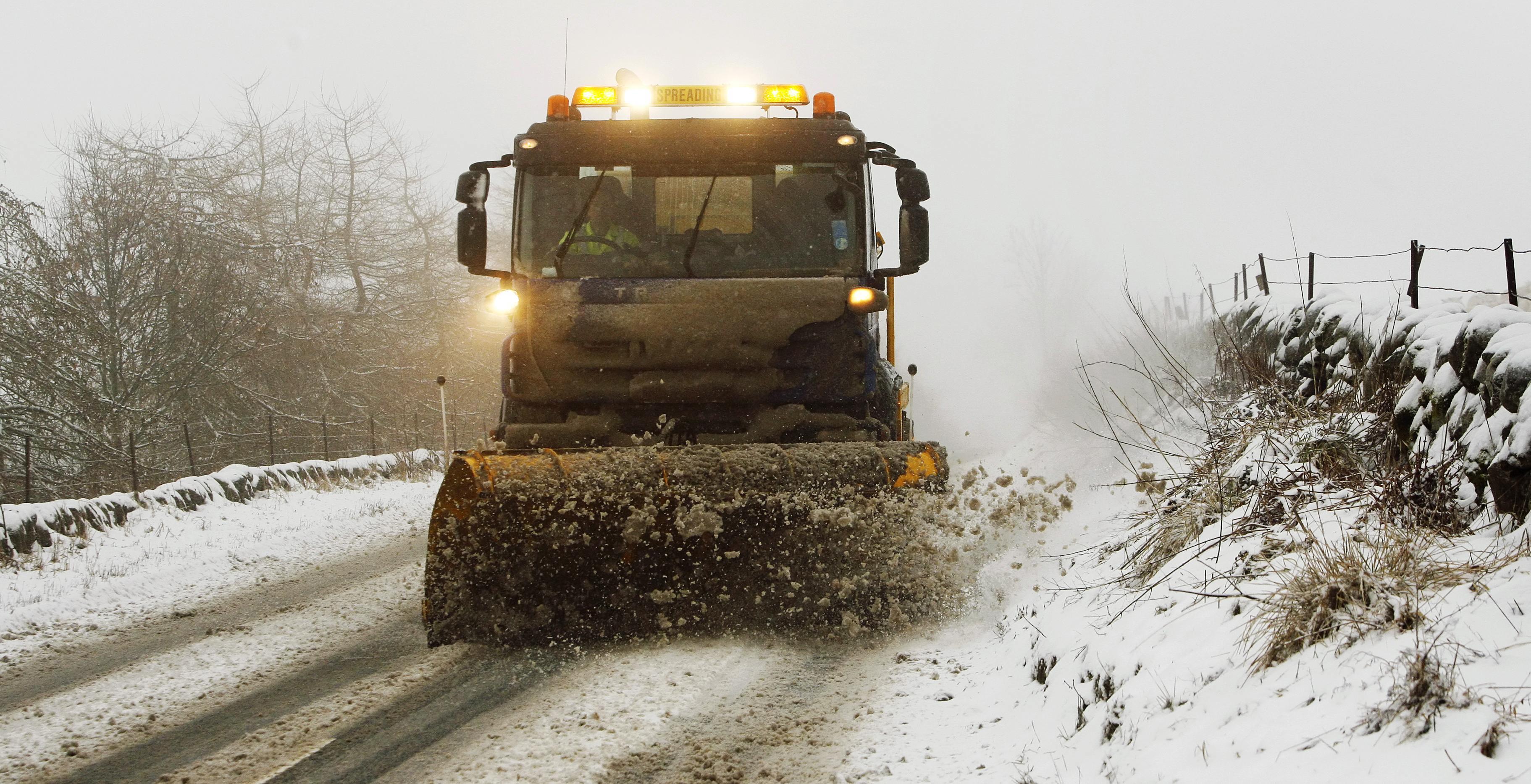 Snow ploughs sent out onto roads (Danny Lawson / PA)