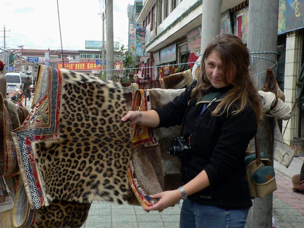 Environmental campaigner Debbie Banks with a leopard skin