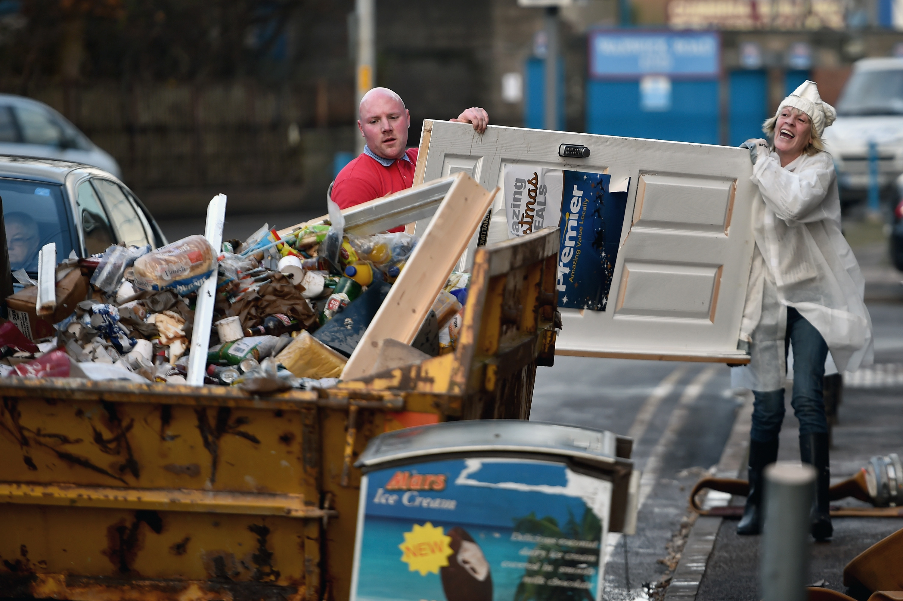 Residents start to empty their possessions from their homes after Storm Desmond flooding (Getty Images)