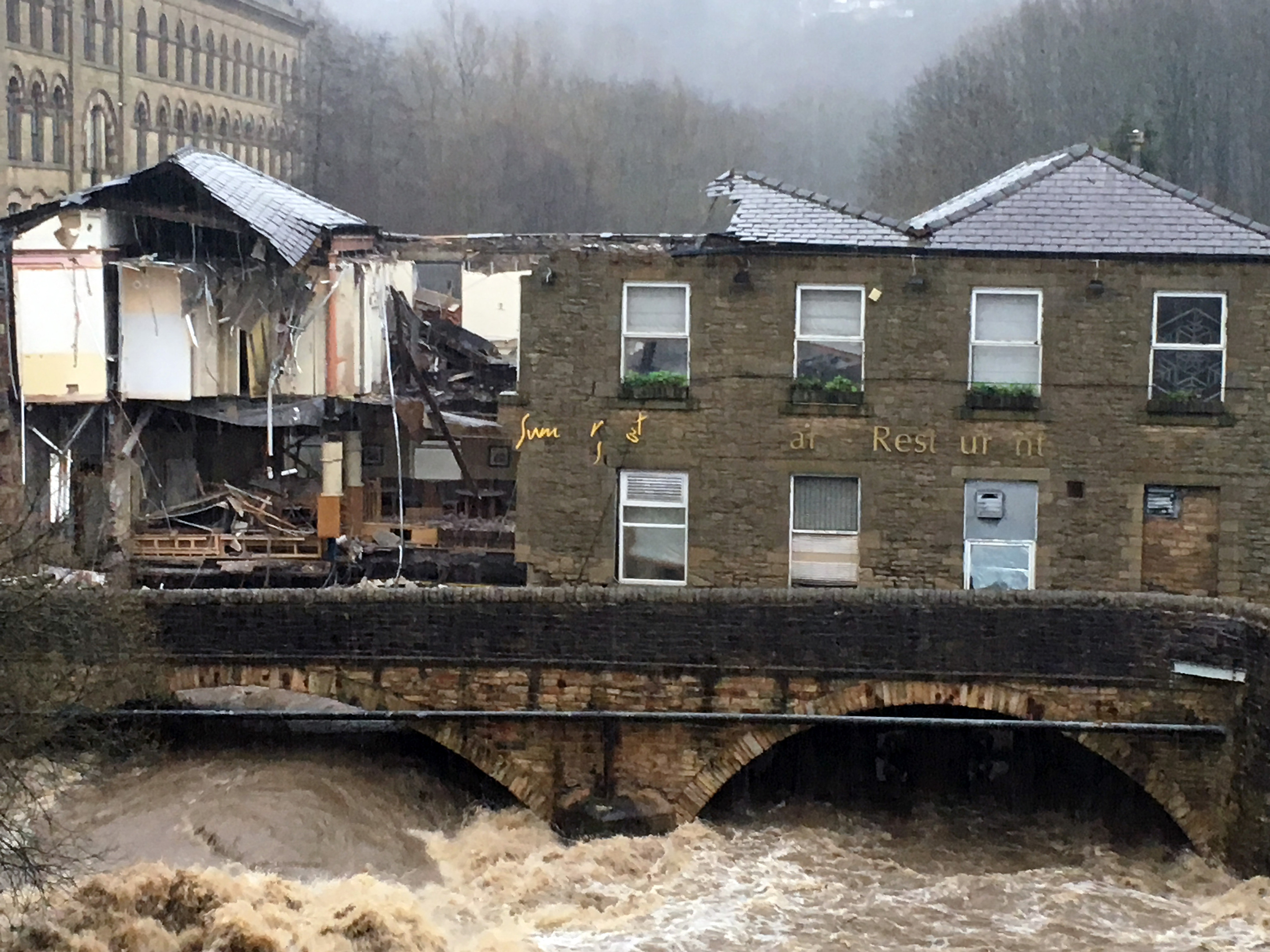 Waterside pub in Summerseat, Lancashire, which partially collapsed due to flooding in the River Irwell.  (Neil Hughes / PA Wire)