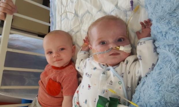 Roman (right) has had a heart transplant and now his parents, Zoe and Craig, hope he'll be home with twin Hunter soon.