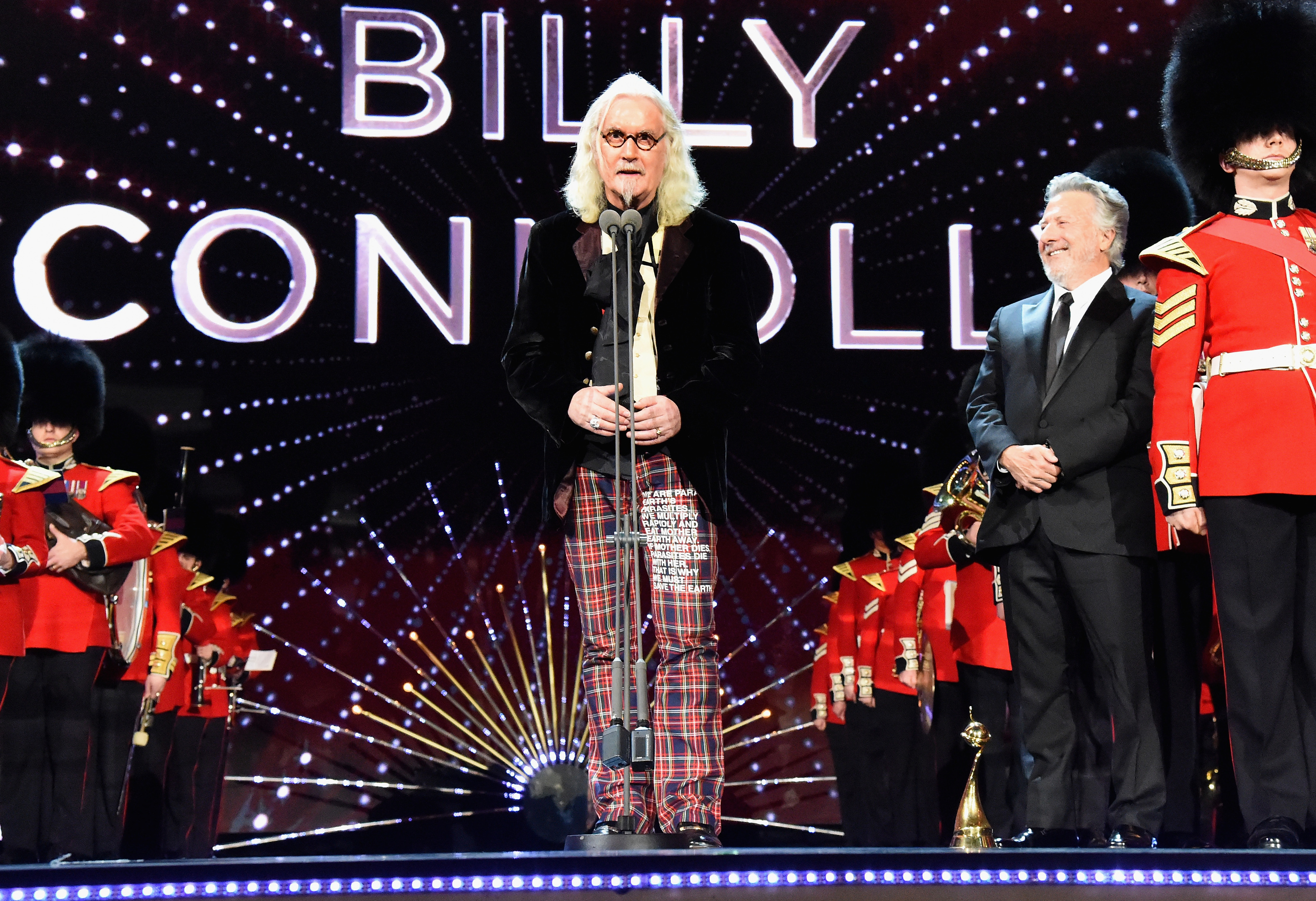 Billy Connolly receives the award for Special Recognition from Dustin Hoffman at the National Television Awards (Alan Chapman/Getty Images)