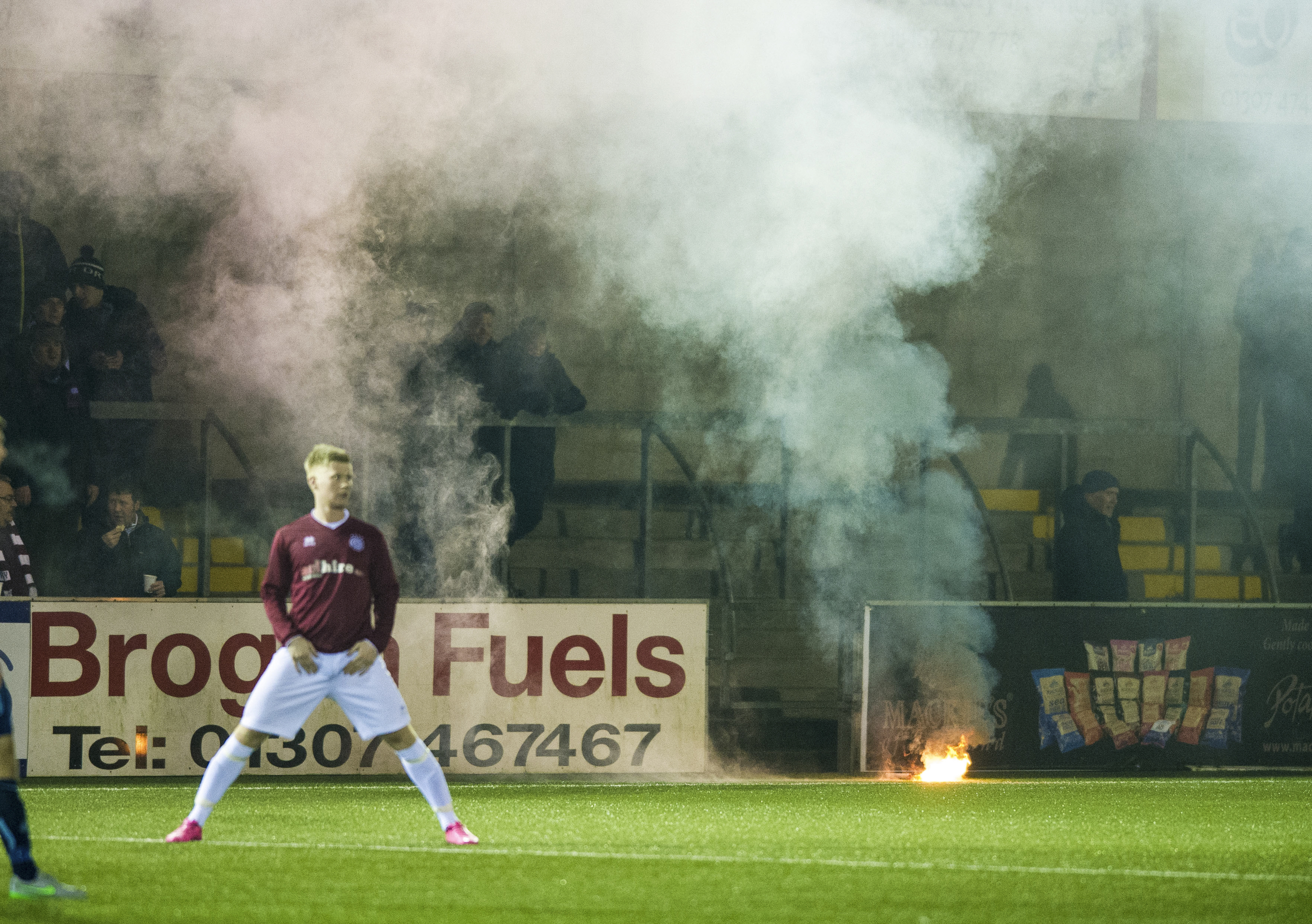 Flares are thrown onto the pitch at Forfar (Ross Parker / SNS Group)
