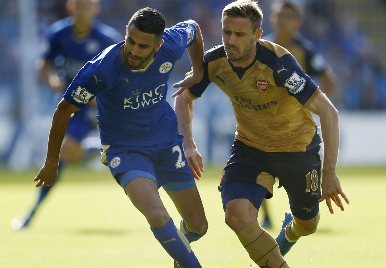 Leicester's Riyad Mahrez fends off Arsenal defender Nacho Monreal (PA)