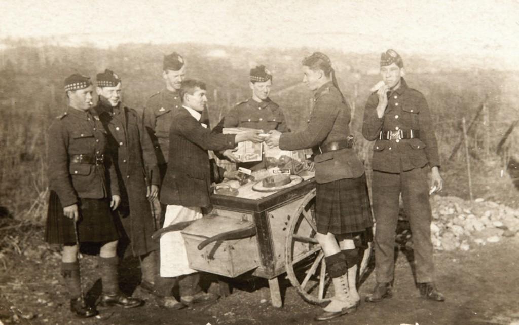 Scottish soldiers being served Jannetta sliders circa 1912.