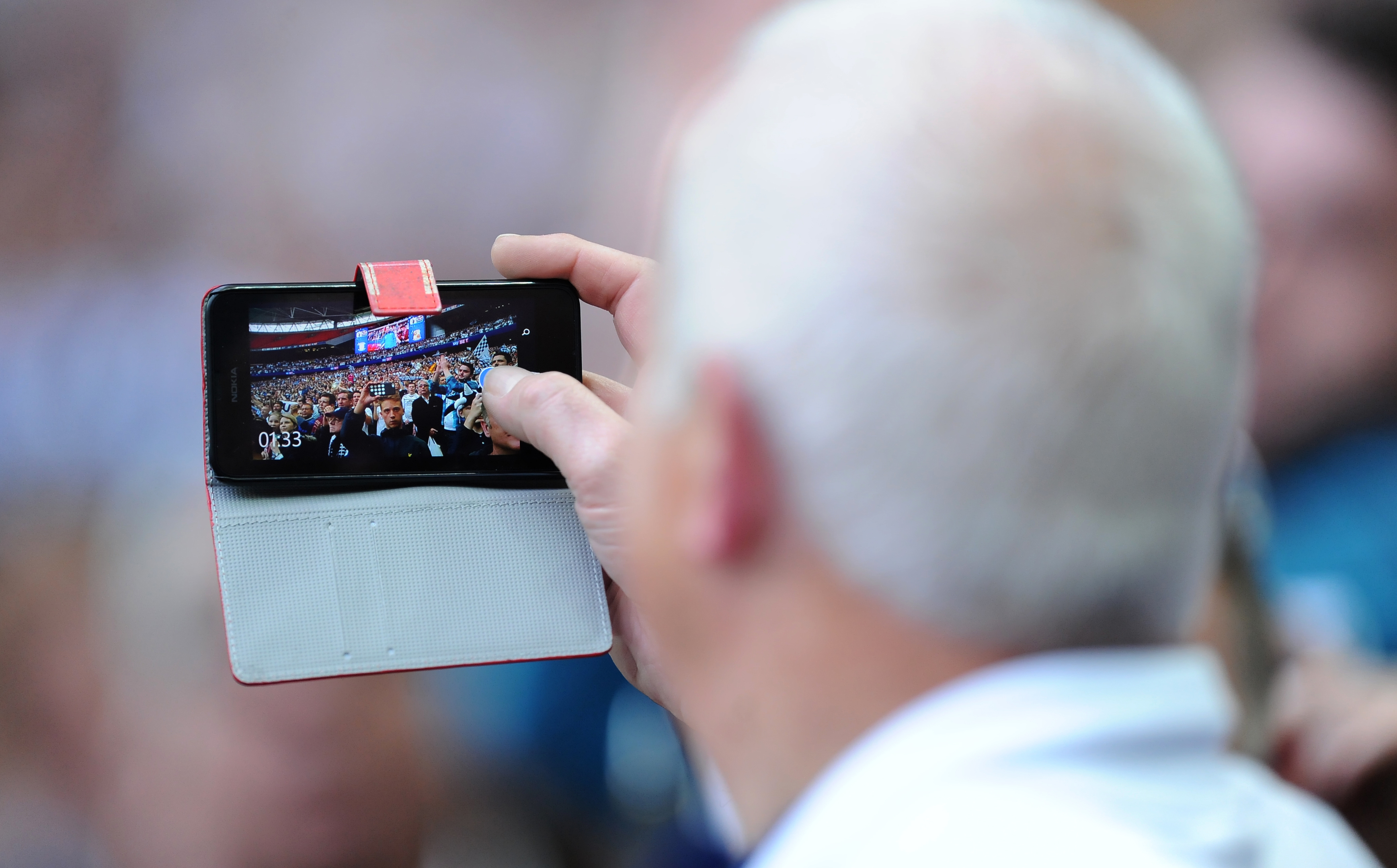 Fans are using technology at games (PA Archive)