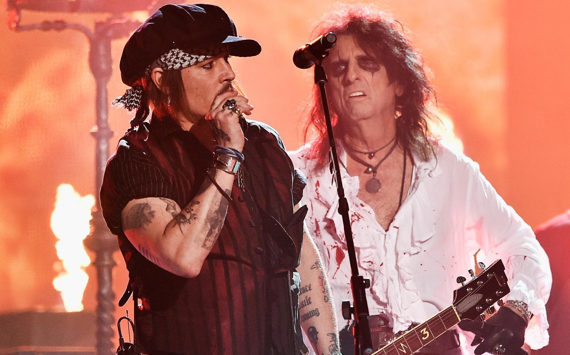 Actor Johnny Depp rocks out with Alice Cooper (Kevork Djansezian/Getty Images)