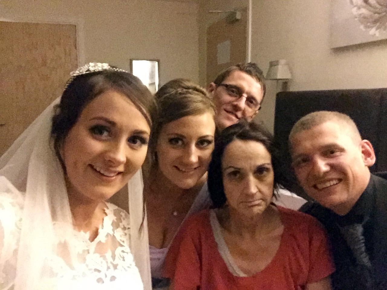 Left to right: Emma Strachan (bride) Elaine Watt (sister), Steven Watt (Elaine's husband), Sandra Strachan (Elaine's mother), Iain Buchan (Emma's husband)