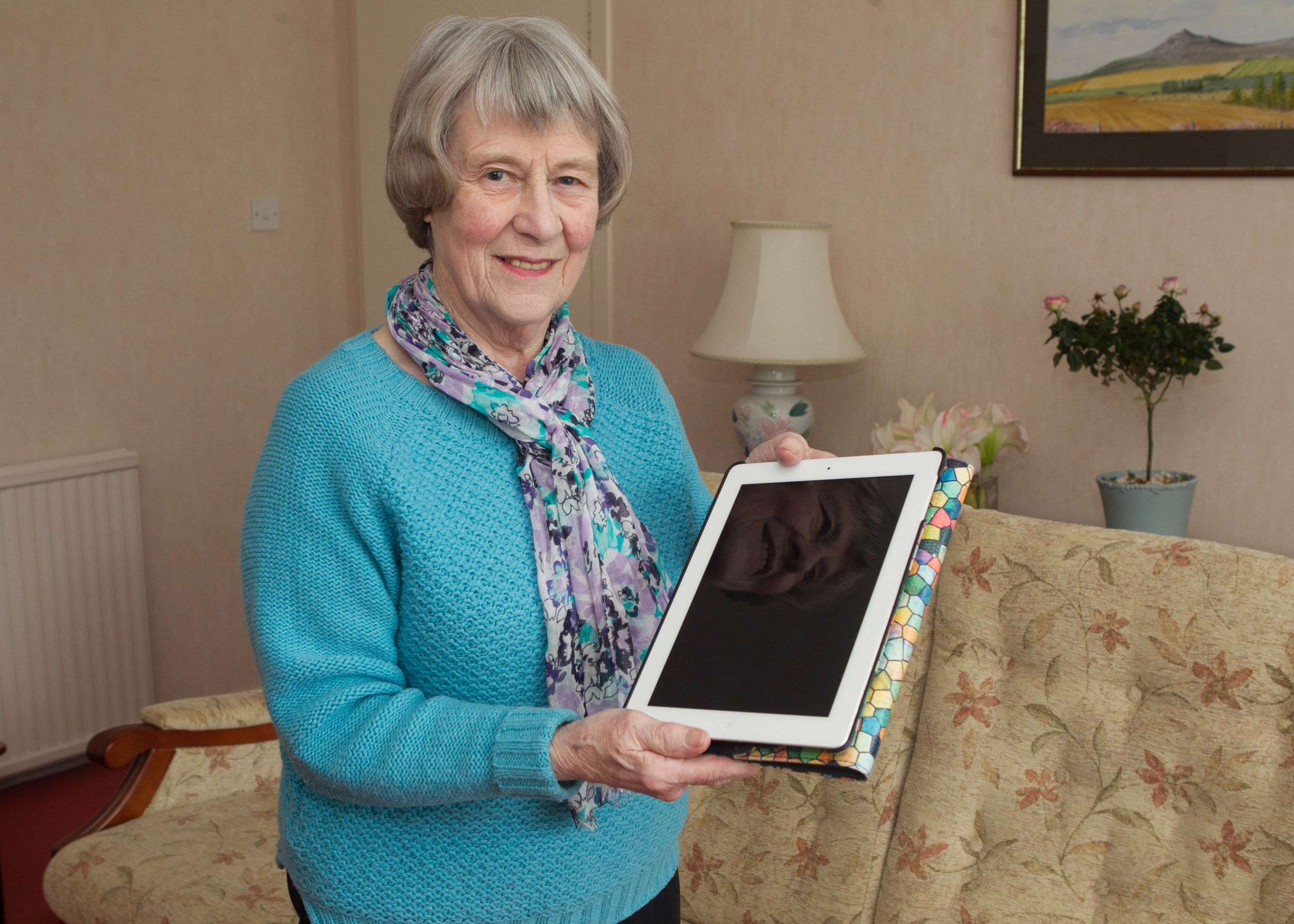 Pam Lawrence has learned how to use an iPad to help her communicate with family in America (Chris Austin / DC Thomson)