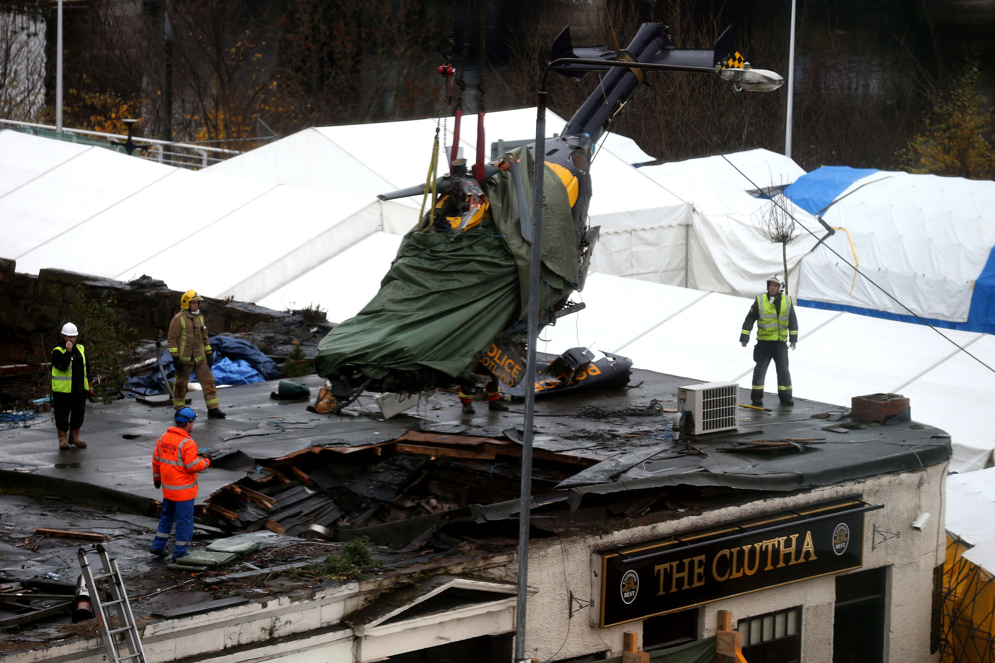 The wreckage of the police three-tonne Eurocopter being lifted from the Clutha Vaults in Glasgow following the crash which killed at least nine people.