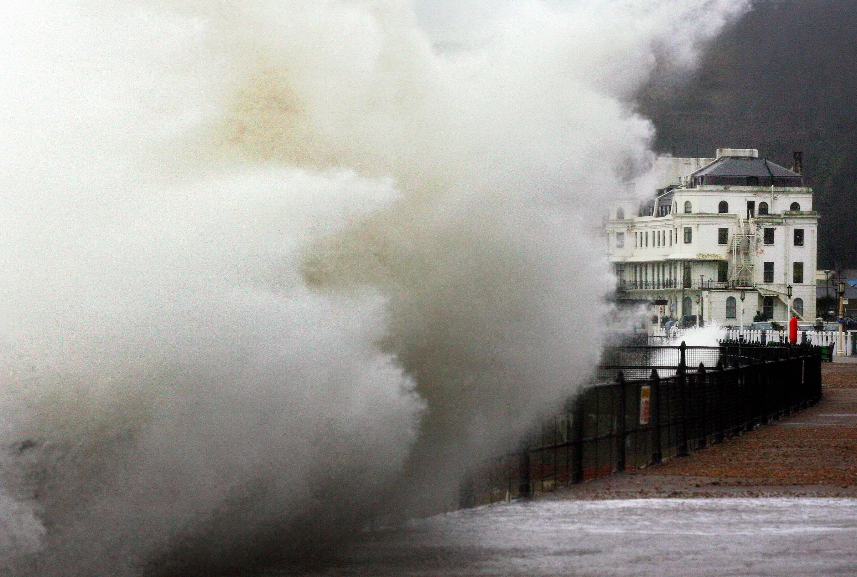 Waves crash over the promenade in Dover, Kent, 2007 (PA Archive)