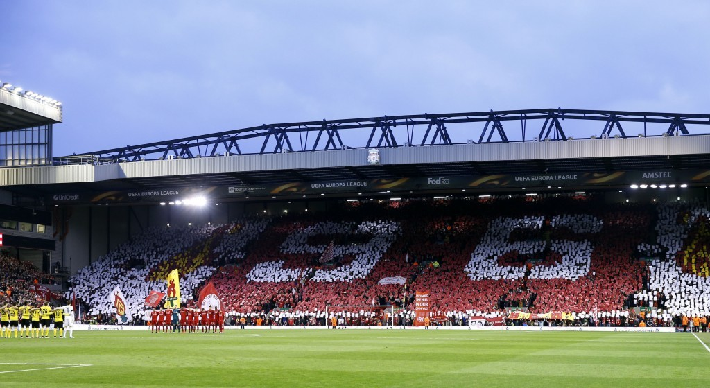 Liverpool players and the fans observe a minutes silence for the Hillsborough disaster in last night's Europa League match against Dortmund (Peter Byrne/PA Wire)