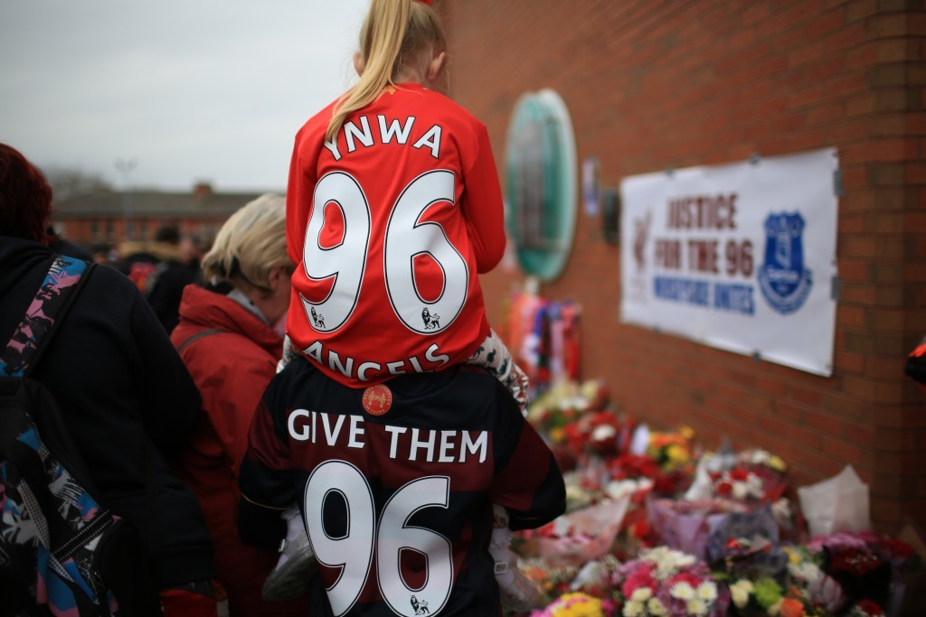 People leave tributes outside Anfield (Christopher Furlong/Getty Images)