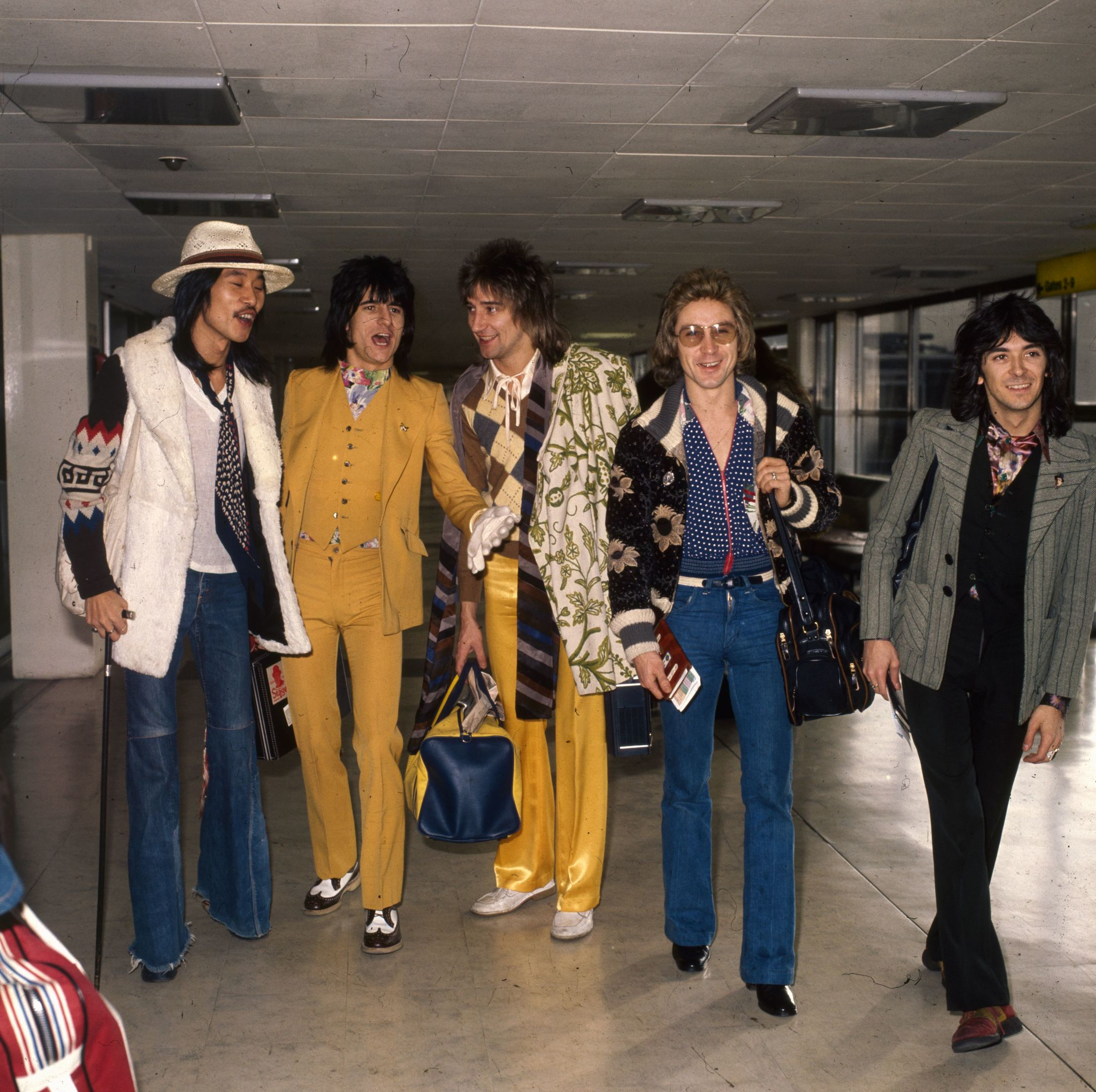 Rod Stewart with the Faces at London Airport. From left to right are: Tetsu Yamauchi, Ron Wood, Rod Stewart, Kenny Jones, and Ian McLagan. (Dennis Stone/Express/Getty Images)