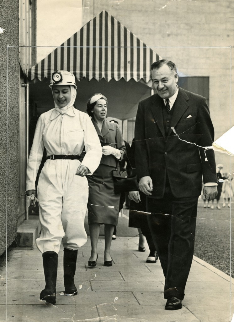 Far from the usual smart skirts and jackets the Queen is dressed in protective clothing during a visit to Rothes Colliery in June, 1958 (DC Thomson)