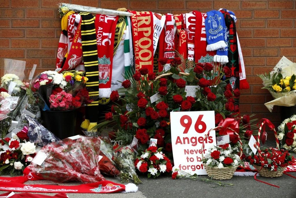 Flowers are placed at the Hillsborough memorial (Peter Byrne/PA Wire)