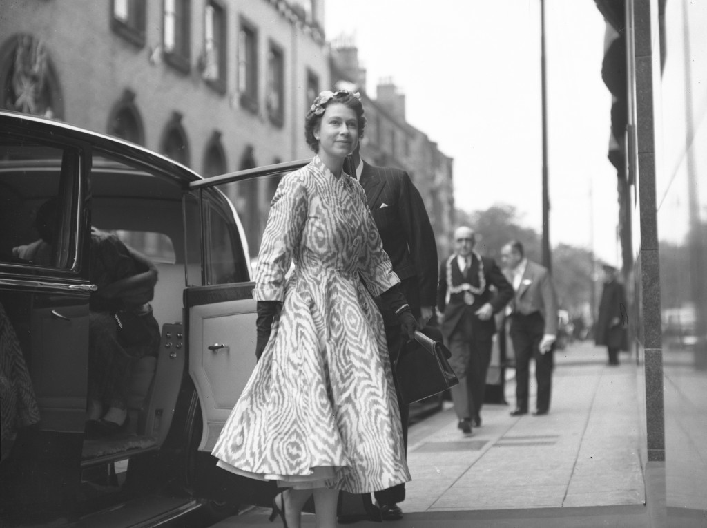 A stylish young Queen exits an official car on a visit to Templetons Factory in Glasgow (DC Thomson)
