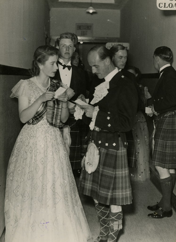 A 20-year-old Princess Elizabeth looks pretty in her dancing gown and tartan sash (AJL)
