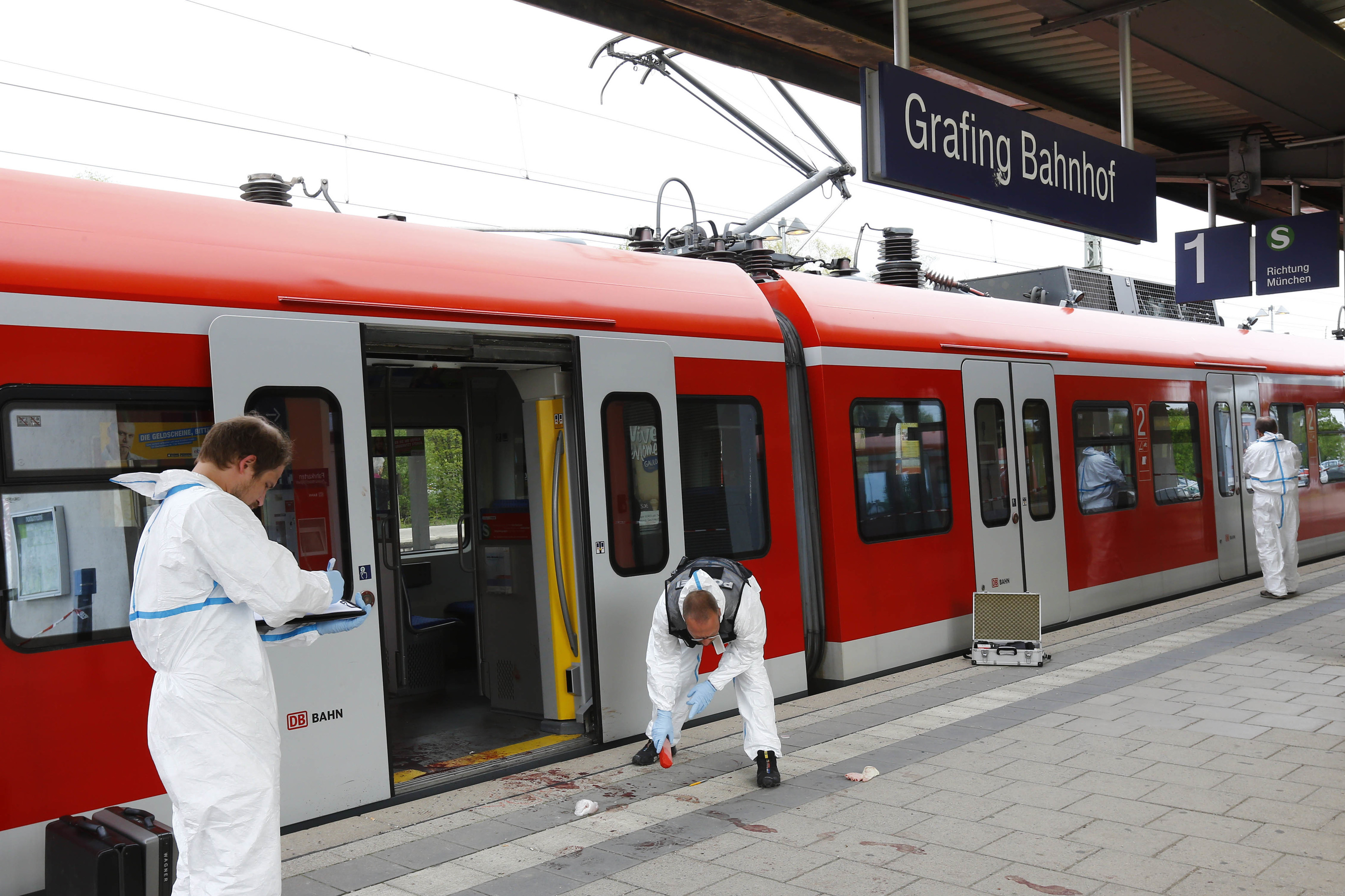 Police investigate the scene of a stabbing at a station in Grafing near Munich (AP Photo/Matthias Schrader)