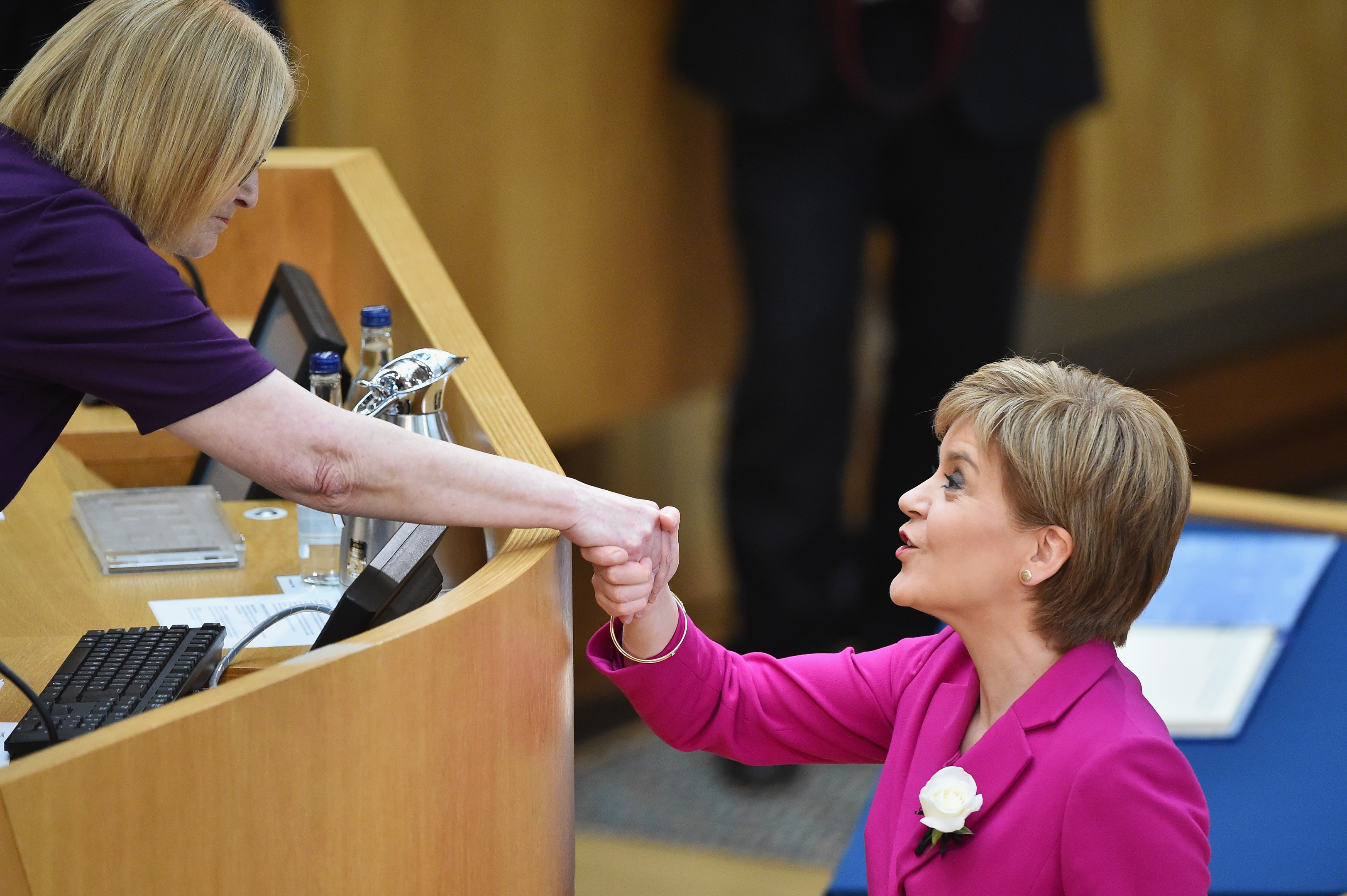 Nicola Sturgeon shakes hands with Presiding Officer Tricia Marwick (Jeff J Mitchell/Getty Images)