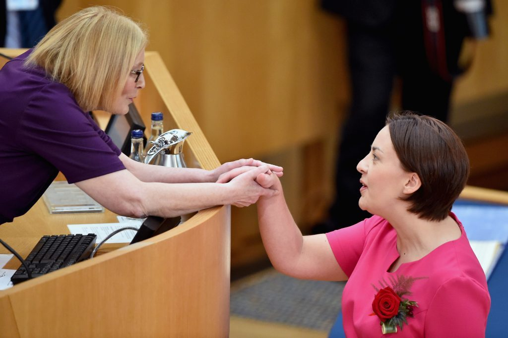 Kezia Dugdale shakes hands with Tricia Marwick (Jeff J Mitchell/Getty Images)