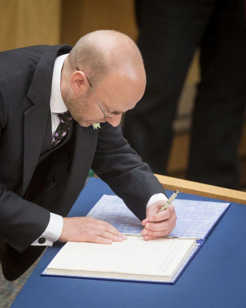 Scottish Greens co-convener Patrick Harvey is sworn in (Danny Lawson/PA Wire)
