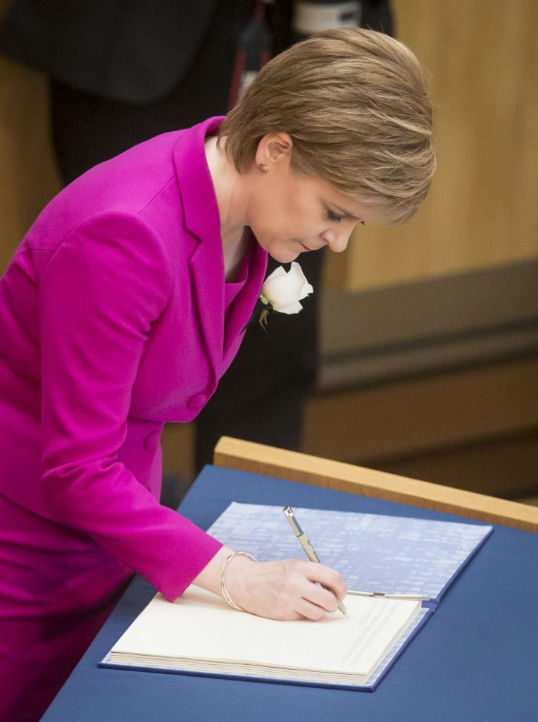First Minister Nicola Sturgeon is sworn in (Danny Lawson/PA Wire)