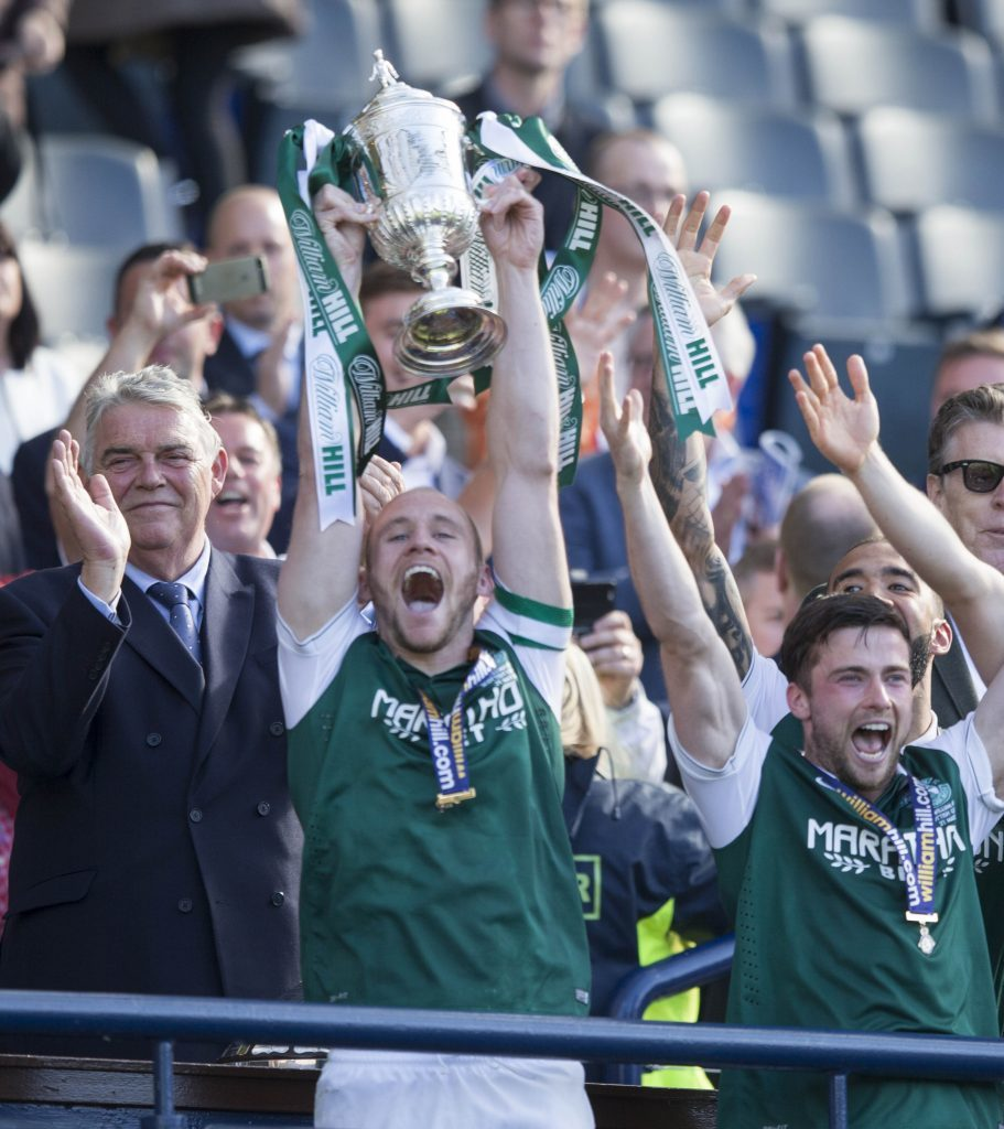 Hibernian's David Gray lifts the cup (Jeff Holmes/PA Wire)