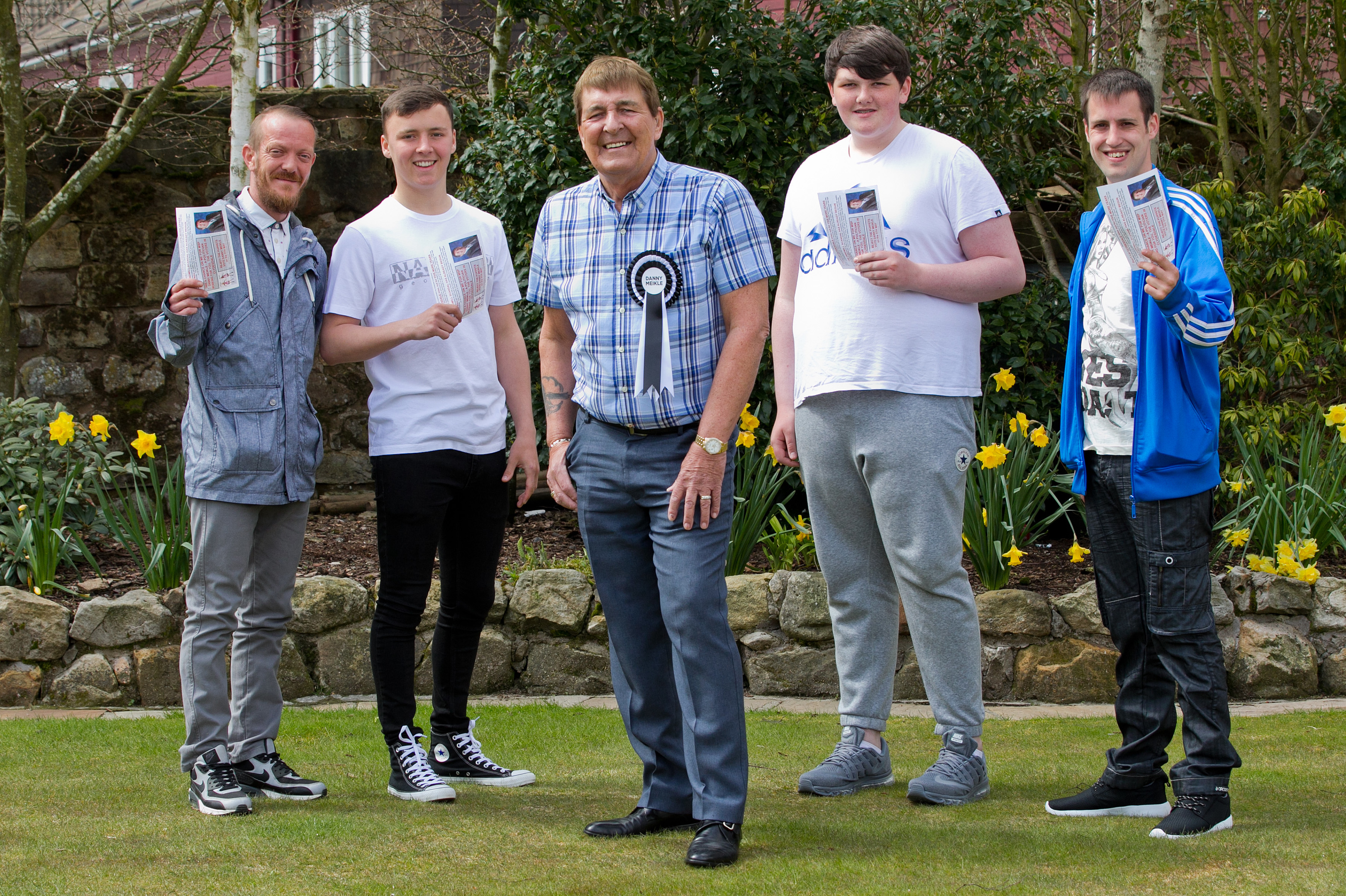 Independent candidate for local elections, Danny Meikle, with four young men who were delivering voting leaflets for him. (L-R): Billy Cowan (37), Lewis Meikle (18) grandson, Dan, Lewis Docherty (16), Donald Douglas (27). ( Independent candidate for local elections, Danny Meikle, with four young men who were delivering voting leaflets for him. (L-R): Billy Cowan (37), Lewis Meikle (18) grandson, Dan, Lewis Docherty (16), Donald Douglas (27). ( Independent candidate for local elections, Danny Meikle, with four young men who were delivering voting leaflets for him. (L-R): Billy Cowan (37), Lewis Meikle (18) grandson, Dan, Lewis Docherty (16), Donald Douglas (27). (Andrew Cawley/ DC Thomson)