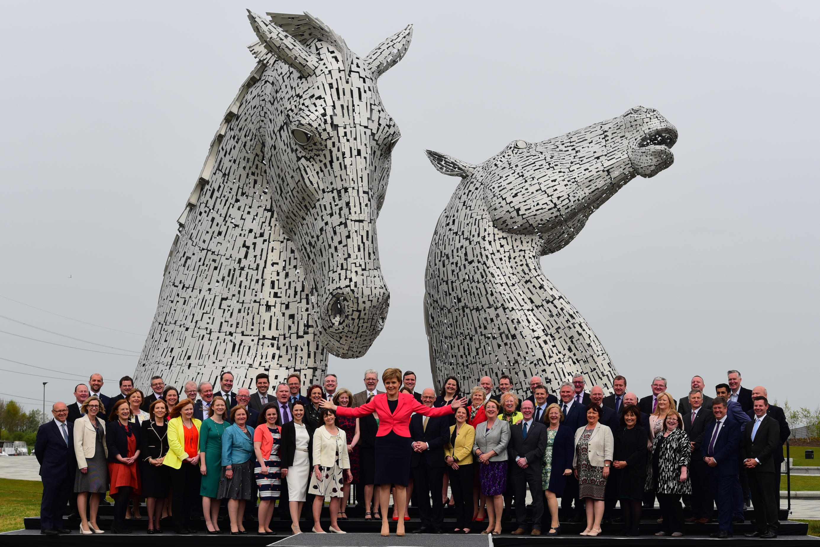 "Scottish First Minister Nicola Sturgeon introduces all 63 new SNP MSPs to the media at a photocall against the the backdrop of ""The Kelpies"" sculpture in Falkirk (Ken Jack / Alamy Live News)"