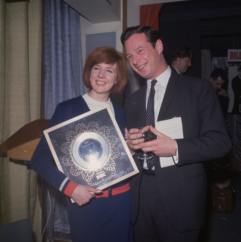 Cilla Black with manager and promoter Brian Epstein and the Silver Disc for 'Anyone who had a Heart' (Hulton Archive/Getty Images)