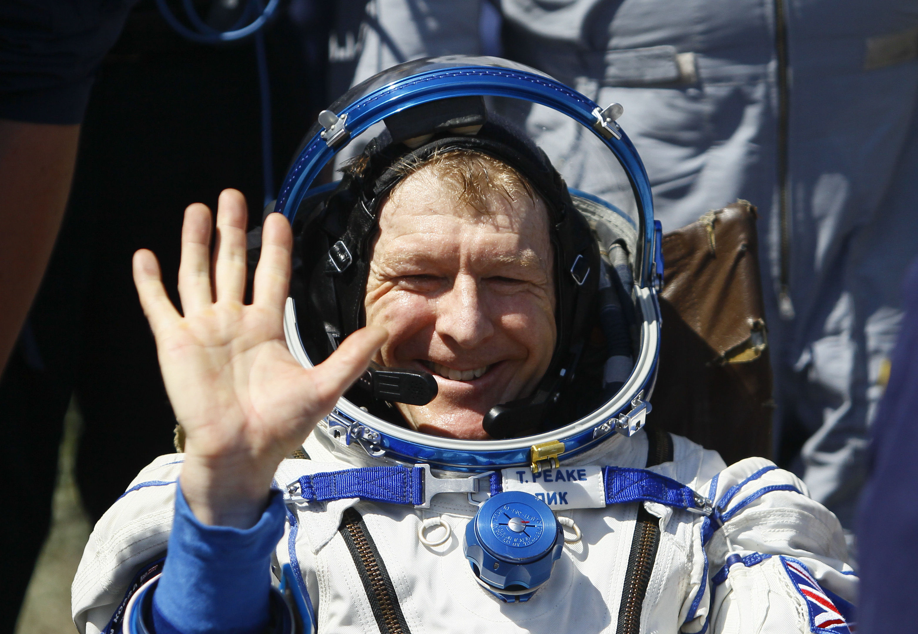 Member of the International Space Station (ISS) crew Britain's Tim Peake waves after landing near the town of Dzhezkazgan, Kazakhstan (Shamil Zhumatov/Pool Photo via AP)