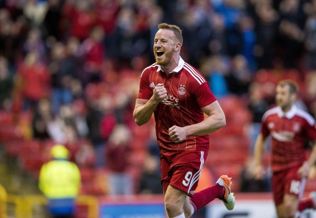 Aberdeen's Adam Rooney celebrates after scoring his side's third (Craig Watson/PA Wire)