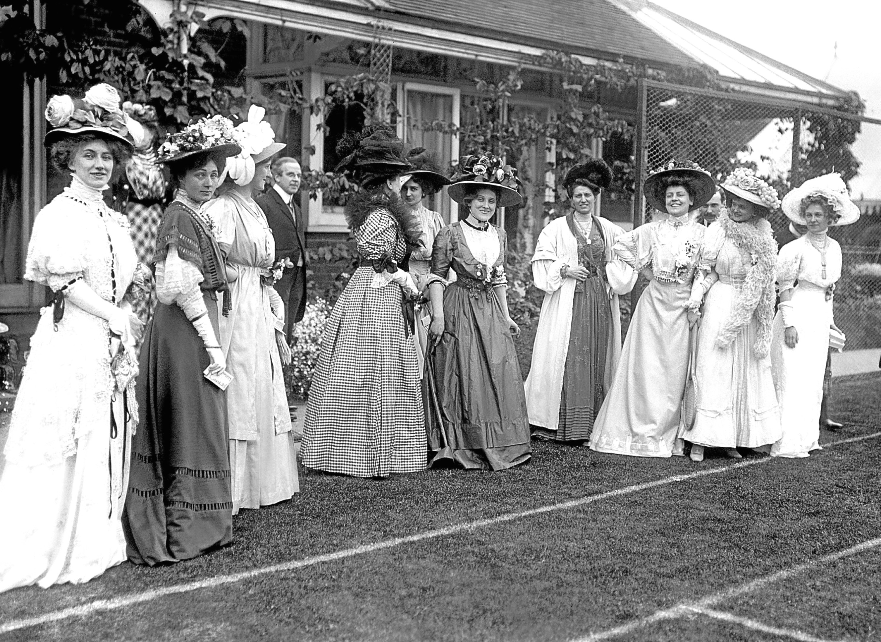 Edwardian fashion being displayed by elegantly dressed ladies during a tennis party at stage celebrity Edna May's wedding.