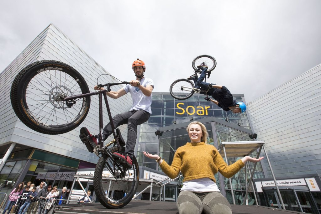 The Clan stunt cyclist with shopper Lauren Fleming (Jeff Holmes)