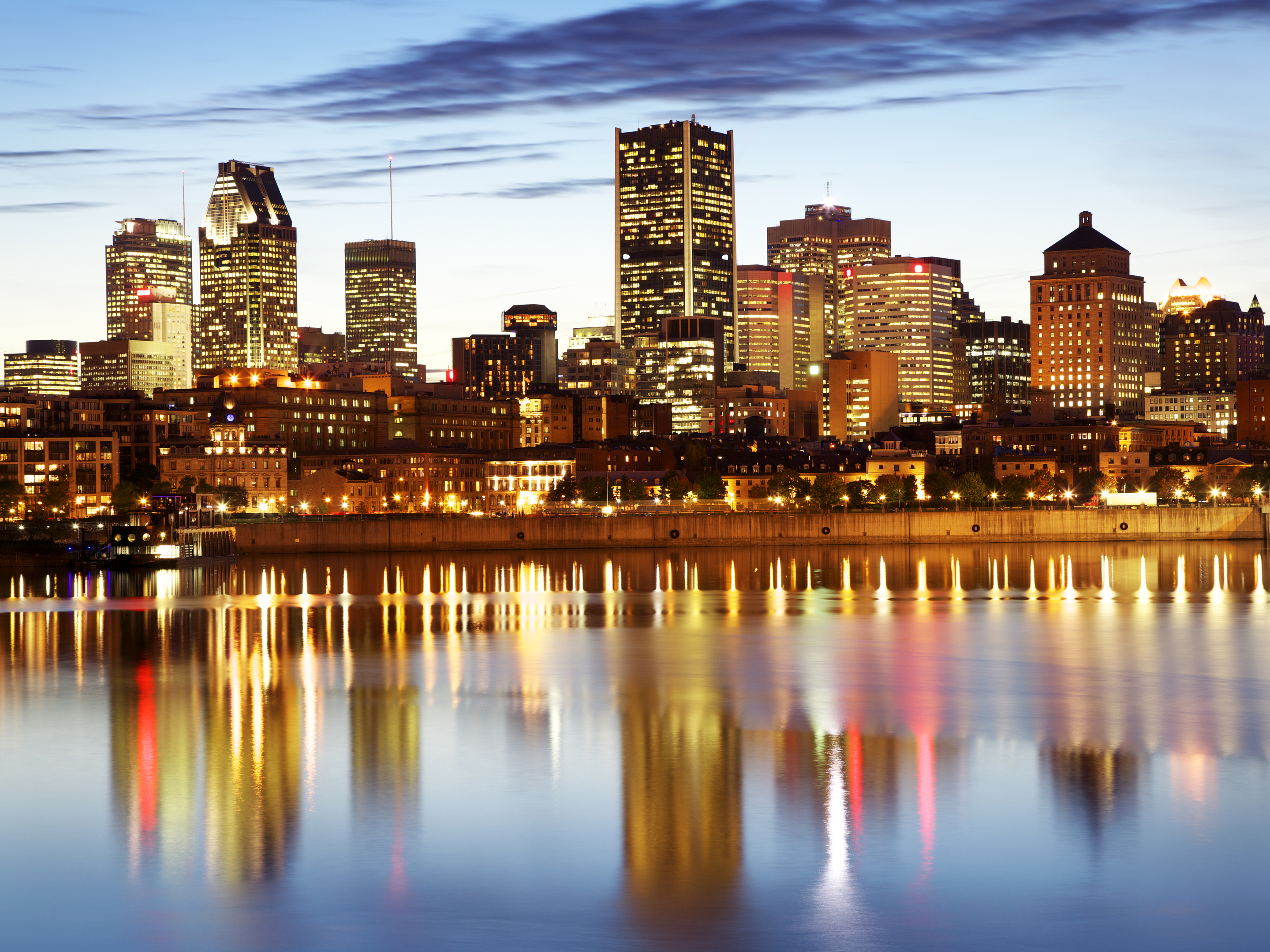 Montreal skyline and Saint Laurent river at dusk