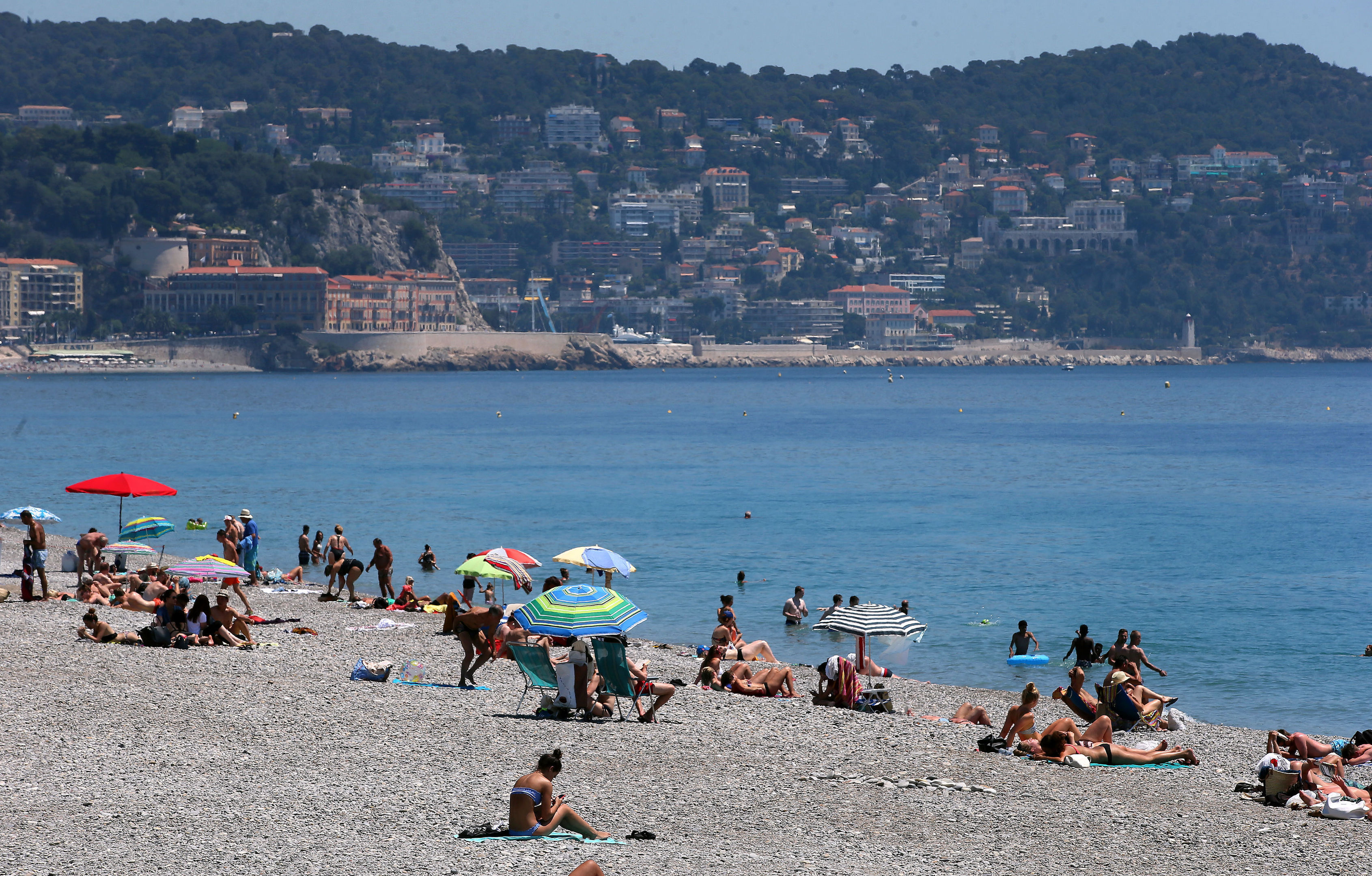 Armed police on French beaches (PA)