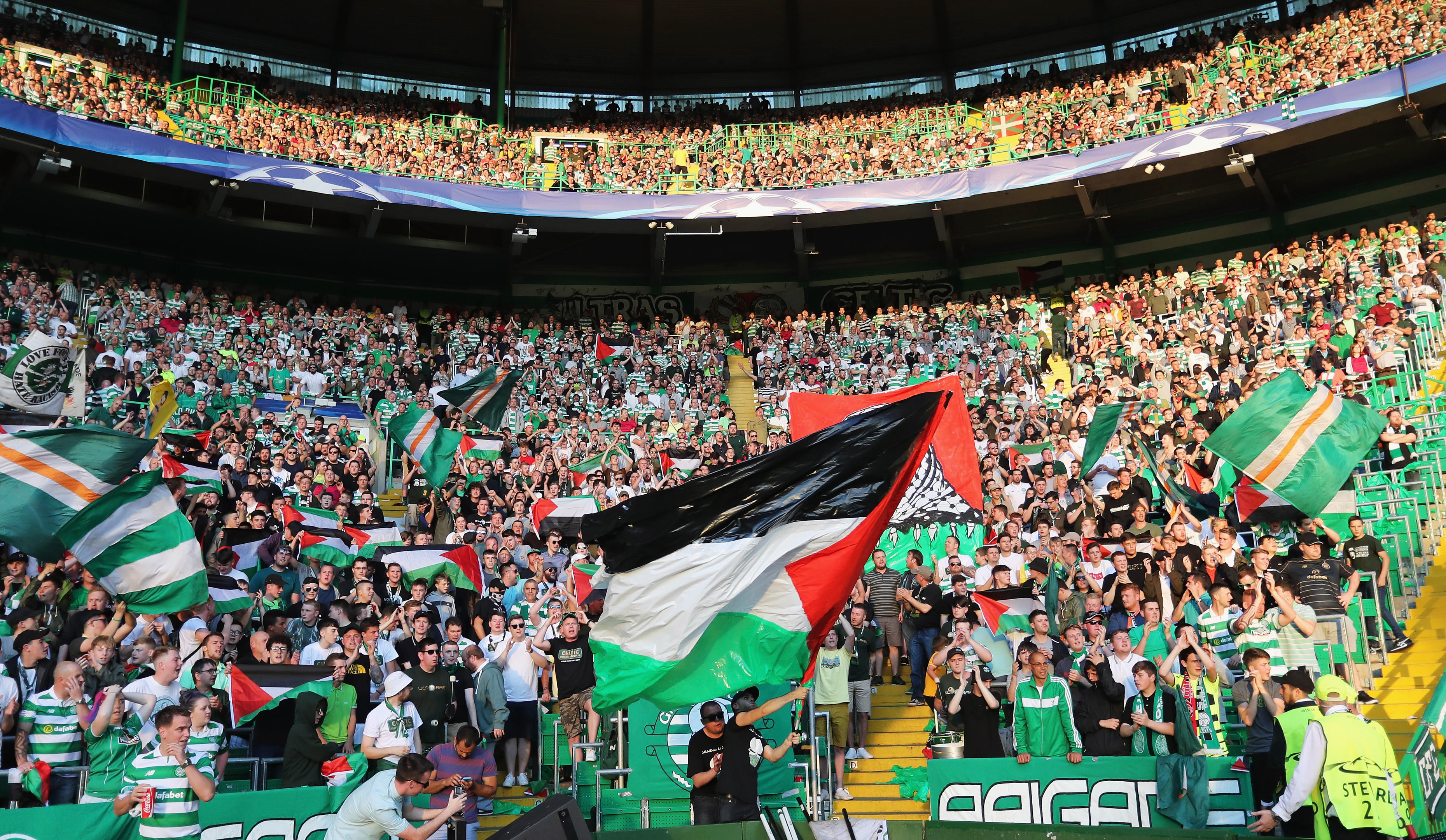 The Palestinian flag is waved by fans during the match between Celtic and Hapoel Beer-Sheva (Steve Welsh/Getty Images)