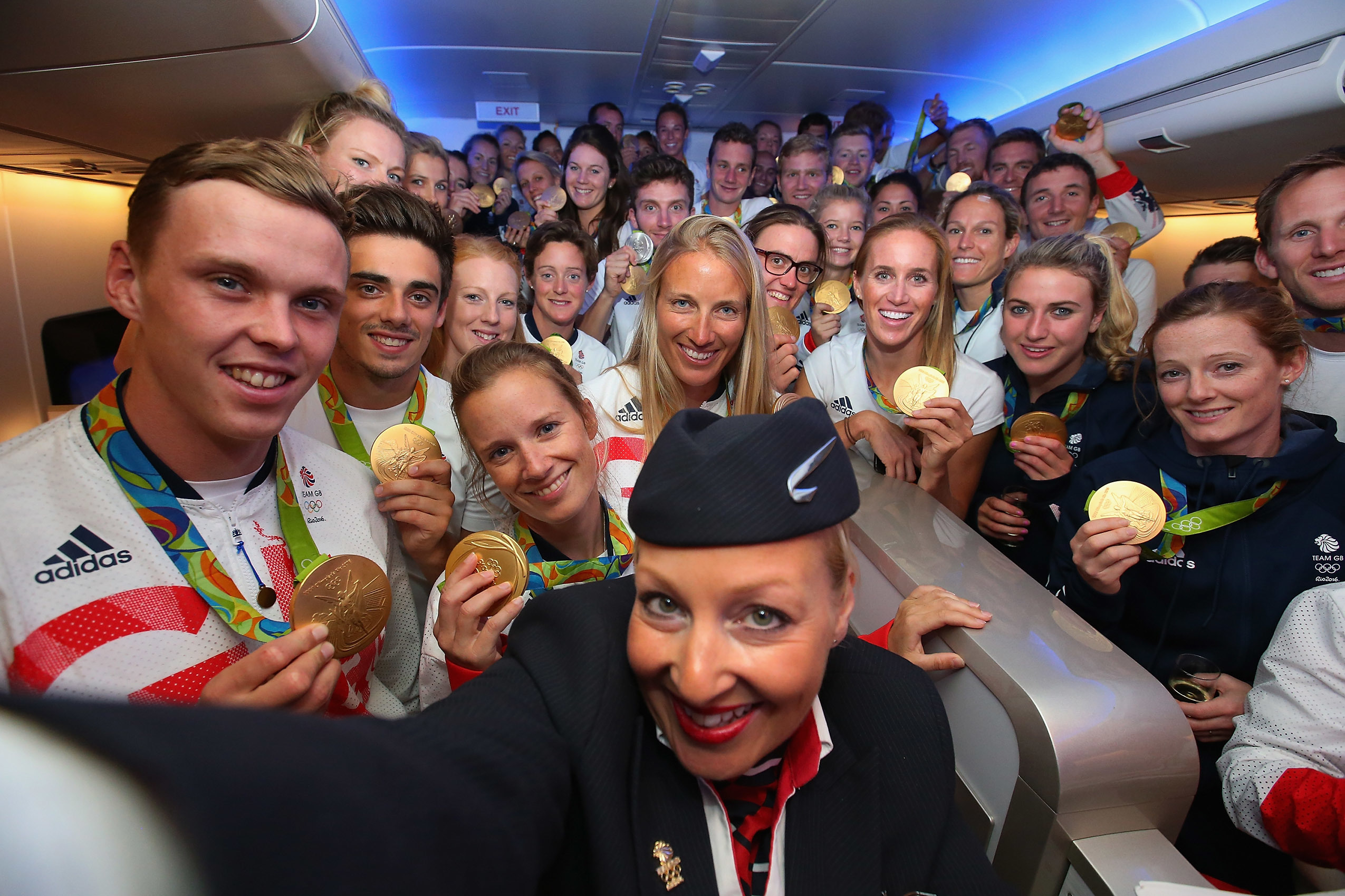 Gold medalists of Team GB pose for a selfie with a member of British Airways cabin crew (Alex Livesey/Getty Images for British Airways)