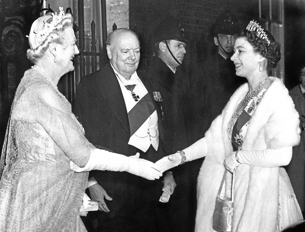 Queen Elizabeth II is greeted by Lady Churchill and Sir Winston Churchill, as she arrives for a dinner party at No. 10 Downing Street (PA Archive)