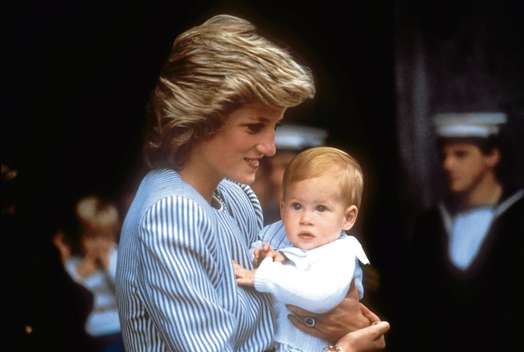 Diana carries baby Prince Harry (PA Archive)