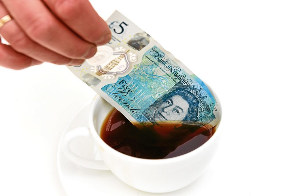 The new fiver survives being dipped in a cuppa (Joe Giddens - WPA Pool/Getty Images)