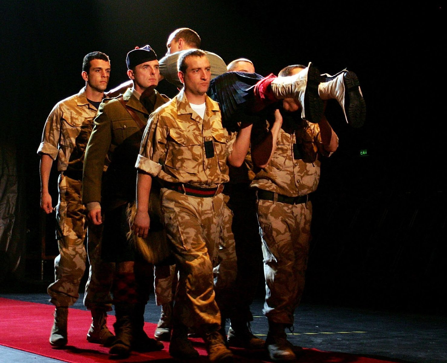 Cast members from the National Theatre of Scotland perform a scene from Black Watch during the 2008 Sydney Festival at the Carriage Works (Lisa Maree Williams/Getty Images)