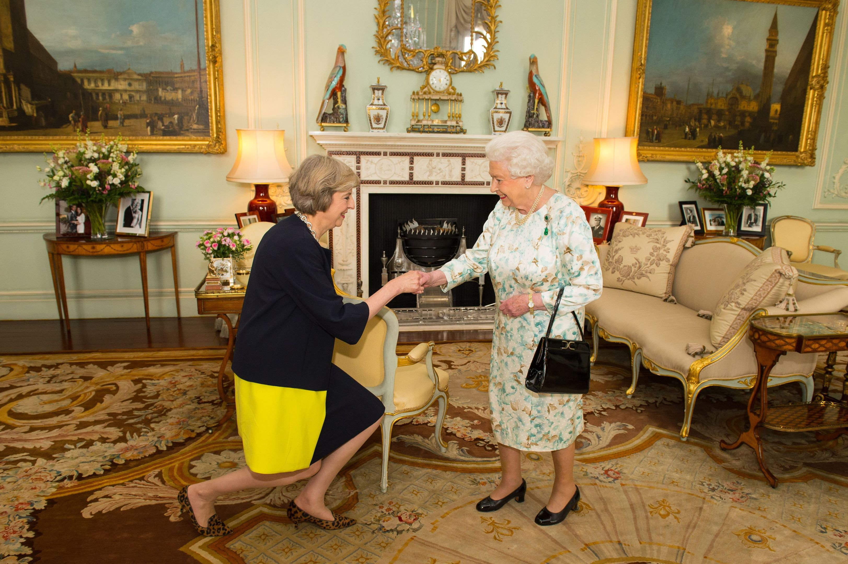 Queen Elizabeth II welcomes Theresa May at the start of an audience in Buckingham Palace (Dominic Lipinski / PA Archive)