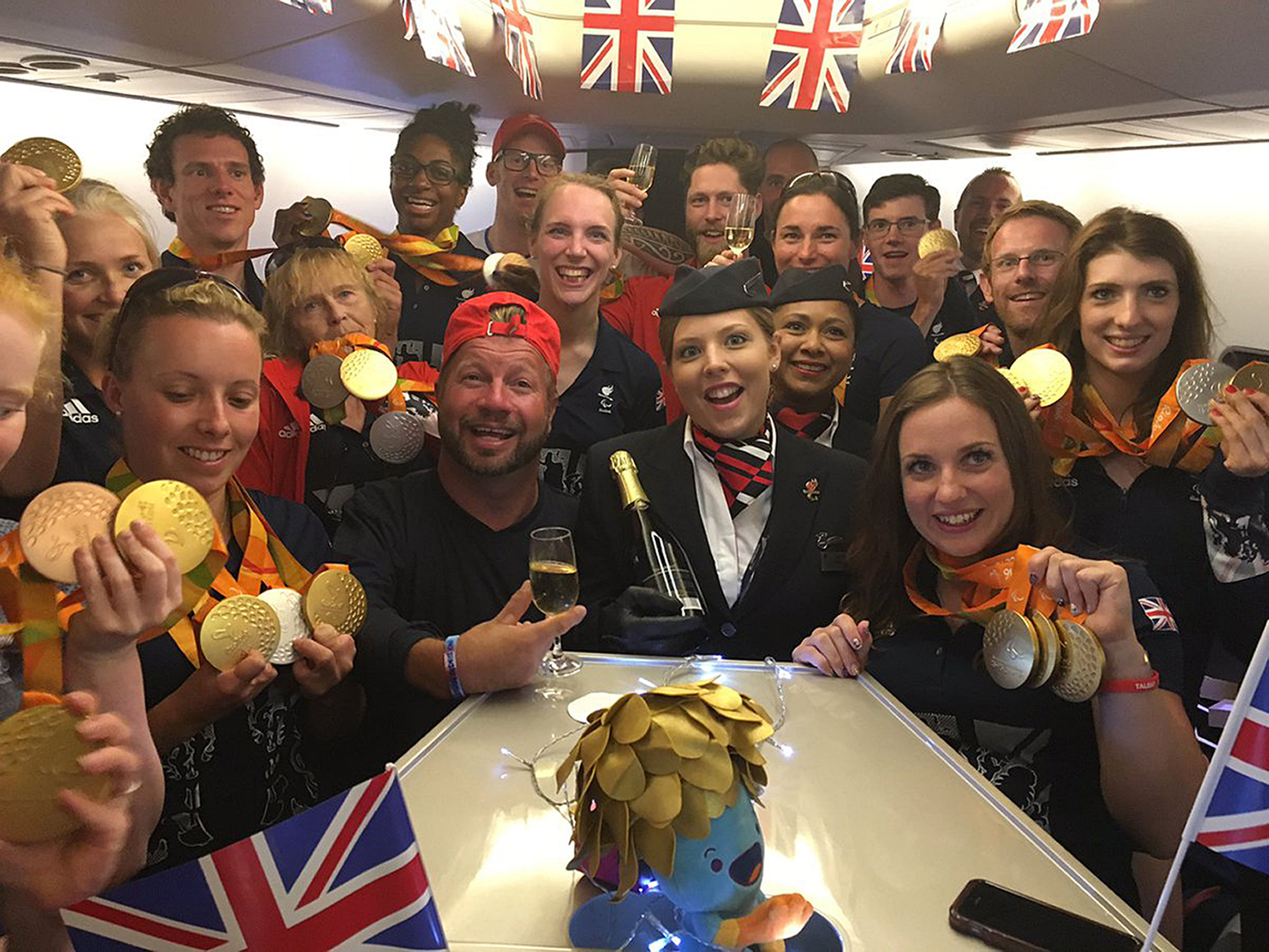 Paralympians on a flight home from Rio to London (PA)
