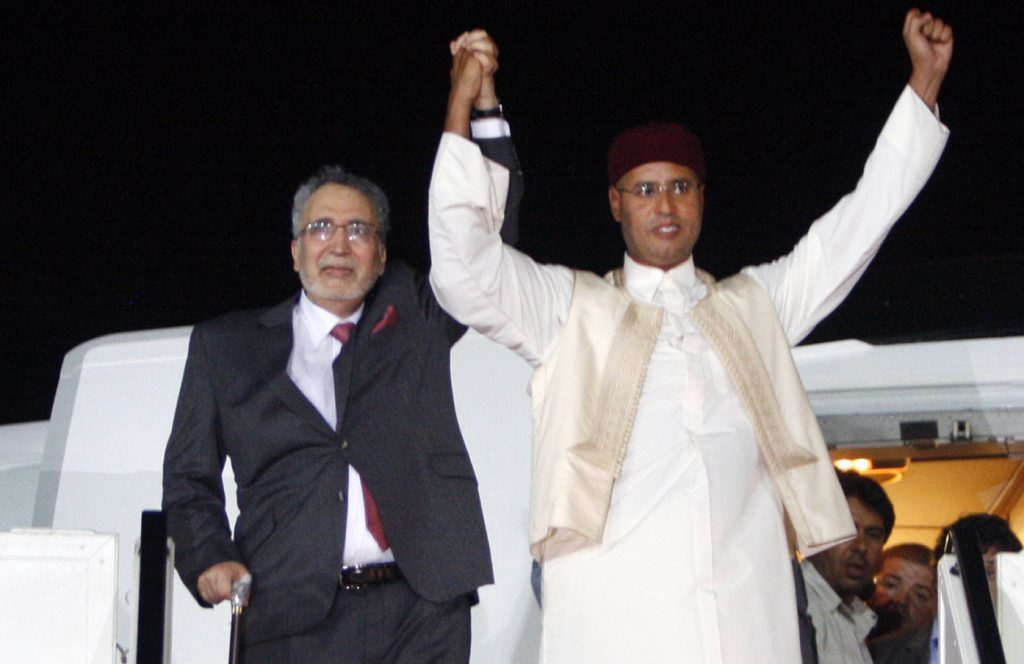 Al-Megrahi with the Libyan leader's son Seif al-Islam Gadhafi, right, on his arrival in Libya after release (AP Photo)
