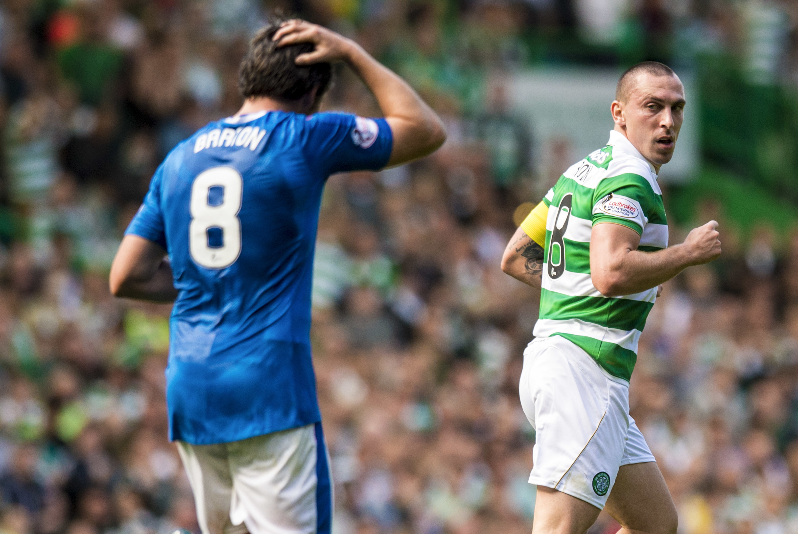 Celtic's Scott Brown (right) with Joey Barton (SNS Group)