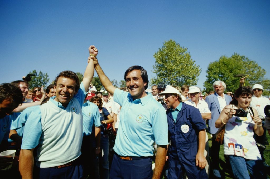 Tony Jacklin (left) and Seve Ballesteros (right) celebrate in 1987. (Simon Bruty/Getty Images)